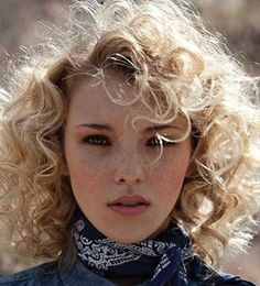 Blonde Curly Hair with Bangs