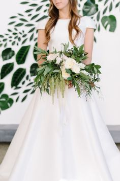 Bridal bouquet via 100 Layer Cake. Copper and Green Industrial Modern Wedding Inspiration. Coordination/concept by Luxe and Luna Couture Events. Photography by Sarah Street Photography. Floral styling and wall installation by Michelle Samson of Taffy Floral. Venue at Work Release, Norfolk, Virginia.