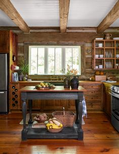 This this cabin, a surround of rustic barn-wood cabinets, topped with teak countertops, makes for a kitchen with lots of warmth and texture.The heart pine floors are milled from 300-year-old beams salvaged from a demolished South Carolina mill.