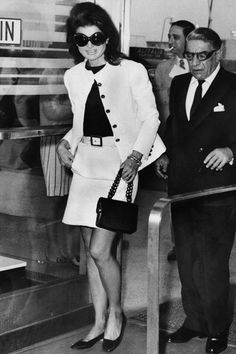 A ladylike take on the trend, Jackie Kennedy-Onassis wears a demure length style with husband Aristotle at JFK Airport in New York.