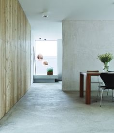 Loving the look of concrete floors, a family renovating their new home in Germany considered all of the alternatives before settling on concrete itself as their most solid aesthetic option. Photo by Mark Seelen.