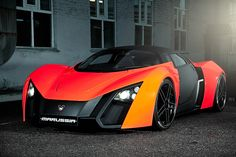"Marussia b2 - The design was meant to give the car a more aggressive look. Some design features include highlighting the grille and intakes in black to contrast them to the car's body colour and emphasize some of the car's geometric elements, as well as styling the car's face to the shape of the ""M"" in the Marussia Motors logo. Engine power is 420 hp, 313 kW, top speed 310 km/h and acceleration 0–100 km/h in 3.8 seconds."