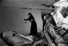 A Palestinian Woman returning to the ruins of her house, Sabra, Beirut, 1982