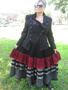 HUGE SALE! WAS $200 BEFORE. This listing features a long skirt with ruffles in black, gray and red colors. This skirt is stunning to wear at Fall/Winter/Spring time, you can wear with jacket to create a Steampunk look or wear it with sweater. Waist is 15 inches unstretch, but