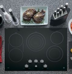 GE 4 Elements Smooth Surface (Radiant) Black Electric Cooktop (Common: Actual at Lowe's. From a gentle melt to a rapid boil, this black electric cooktop by GE allows you to cook with flexibility and style. With four radiant cooking elements to Best Appliances, Kitchen Appliances, Induction Heating, 4 Element, Keep Food Warm, Electric Cooktop, Apple Homekit, Glass Cooktop, Heating Element