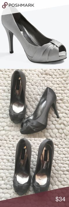"""White house black market gray satin bow pumps 7 White house black market gray satin bow pumps size 7.  Sleek satin pump wrapped with a bow at the peep toe. Glossy 4.25"""" heel; .5"""" platform. Satin upper; leather sole. Imported. Excellent preowned condition. Worn once. White House Black Market Shoes Heels"""