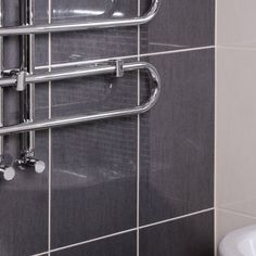 Delfos Grafito wall tile is a glossy elegant tile. Together with our Isla border tile creates a stylish look. Border Tiles, Bathroom Wall, Wall Tiles, Door Handles, Elegant, Stylish, Home Decor, Graphite, Room Tiles
