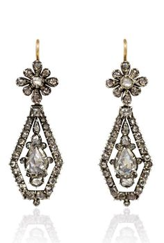 A pair of antique rose-cut diamond earrings comprised of kite-shaped pendants and florette tops, in 18k and sterling silver. Circa: 1810