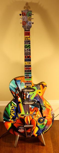 Painted hollow body guitar. Coolest design ever. Would actually look awesome on any piece of wood u could paint on..