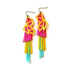 Futuristic neon geometric earrings made from hand cut triangular and hexagonal forms from metallic gold leather. Behind the geometric lattice are t. Aztec Earrings, Pink Earrings, Fringe Earrings, Turquoise Earrings, Leather Earrings, Leather Jewelry, Statement Earrings, Dangle Earrings, Neon Jewelry