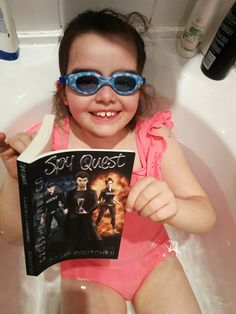 Katy copying her big brother. Also Re-reading 1 of her favourite book.