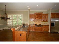 Spacious kitchen, opens to family room, features granite counter tops, breakfast bar, custom cabinetry and stainless steel appliances *Contact Karen Cannon Realtors 770-352-9658