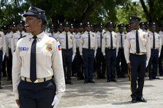 Police graduation in Haiti    As part of capacity building of the government and the communities of Haiti, UNDP has contributed to the professionalisation of 2,700 people in areas critical for recovery and development. This includes vocational training for all judicial actors (judges, registrars, police officers).  Photo: UNDP