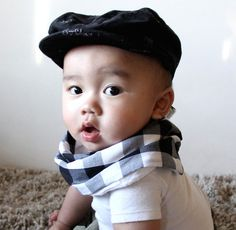 Scabib scarf style bibs for babies. The newest coolest thing we're in love with!