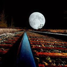 I hear the train a comin'  It's rollin' 'round the bend,  And I ain't seen the Blue Moon,  Since, I don't know when.