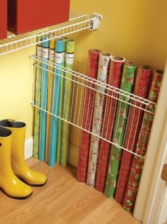 This is such a great way to store wrapping paper so it doesn't get wrinkled, stepped on, take up space, etc!