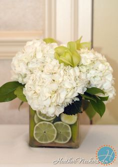 white hydrangeas with foliage and limes