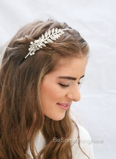 Grecian Silver Tone Metal Leaf and Flower Headband with Rhinestones and Pearls.  This wedding headpiece features a silver toned metal leaf and a crystal and silver flower. I covered the headband with rhinestone chain and added wired pearls around the flower to create this pretty headband for adults. Silver Leaf Hair Accessory.  Perfect for a night out on the town or for a wedding. This would also be great for your bridesmaids to wear on your wedding day.  Grecian headband, Silver, Metal Leaf…