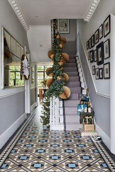 Christmas hallway decorating ideas to impress your guests. These hallway solutions will make you feel festive the moment you step through the front door Entrance Hall Decor, Decoration Hall, House Entrance, Small Entrance Halls, Hall Way Decor, Hall Tiles, Tiled Hallway, Upstairs Hallway, Weihnachten In London