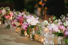 Beautiful table lined with lush bouquets of garden roses, maiden hair fern, spray roses, nigelia, peonies and queen annes lace, reception at horticulture center ,Nancy Saam Flowers Photo from Ian & Kelley collection by We Laugh We Love