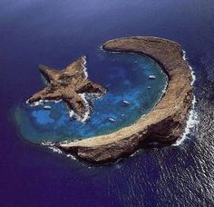 Island of Molokini - natural star and crescent - between Maui and Kahoolawe. I love this place! It's so cool, and it's surrounded by large amounts of sea life so it's the BEST place to snorkel or scuba dive.  Can't wait to go back!