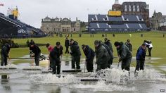 Play at The Open golf tournament in St Andrews was halted due to the rain early in the day, with play suspended for several hours.