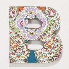 Paint wooden block letters {from Michaels} and mod-podge front with funky fabric or paper.