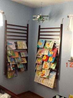 I made these bookshelves out of Bs old crib. He moved into his big boy bed so I took his crib down, hot glued some foam blocks to the back bottom, threaded some jute thru the top & now we have bookshelves for free!! Yay MOM-ME!
