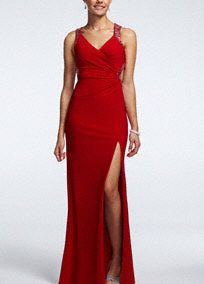 You will look fierce on prom night in this sleek and stunning prom dress!  Sleeveless bodice with V neckline and silver sequin embroidered straps.  Features intricate strappy open back detail.  Long and soft silhouette with side slit is sexy and sultry.  Red is available in stores and online. Indigo is available in stores only.  Fully lined. Back zip. Imported polyester/spandex blend. Professional spot clean only.