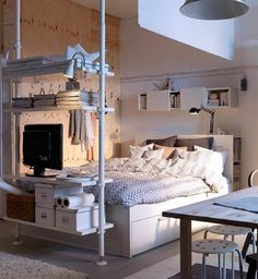make your own room divider, piping and shelves at foot of bed...becomes a media centre