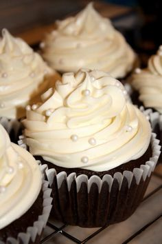 Chocolate Champagne Cupcakes with Strawberry-Cheesecake filling and White Chocolate Champagne Buttercream Frosting. Is that enough chocolate for ya?