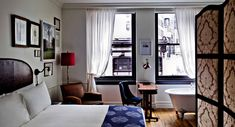 The NoMad Hotel | Midtown Manhattan Luxury Hotels. All 168 guestrooms feel like apartments (fittingly, as Garcia drew inspiration from his childhood flat in Paris). Think reclaimed maple floors, antique Heriz rugs, and wall hangings found in vintage shops (black-and-white French photographs, record sleeves). Wash closets and freestanding clawfoot tubs (in most rooms) with Argan bath amenities by Côté Bastide add to the Euro apartment feel.