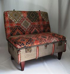 A worn out vintage canvas trunk is recreated into a suitcase chair with a steel and timber reinforced internal structure, tapered timber legs and beautifully upholstered in soft Kilim style fabric. - From www.recreate.za.net