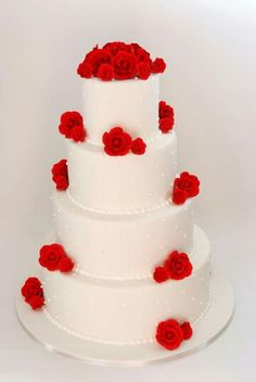 White wedding cake with red floral details...love it!