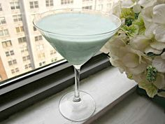 Creamy Blue Daiquiri (2 oz. Rum 1 oz. Cointreau 1 oz. Lime juice 1/2 oz. Simple syrup 1/2 oz. Blue Curacao 2 oz. vanilla ice cream or frozen yogurt)