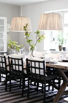 We will have a dining room someday for our china to live in and our family to party in! Here's the colour scheme I like: soft grey, bright white, and a darker accent.