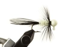 Glow Bugz White & Black Jig - Glow in the dark heads are great for ice fishing, deep water fishing, night fishing. The glow is the same color as the head paint, except white, which gives off that greenish glow. Tied with glow-in-the-dark custom chenille. Great for sunfish, bluegills, any panfish, crappies, walleye - they all love the subtle glow! Hand Tied by our friends at Haggerty Lures. Made in the USA! Please note size refers to the hook size and weight refers to the jig head weight.