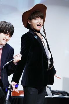 Jungkook being adorable ft. Suga in the background