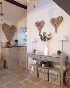 Country home with a modern feel...wicker hearts and soft greys mixed with wicker. #westbarninteriors #westbarnstyle #convertedbarn #cosy #countryhome #countryinteriors #housebeautiful