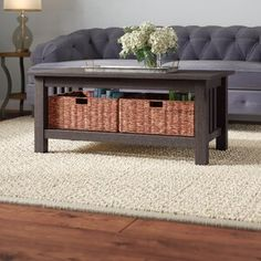 Is seating ensemble feeling empty? Try a coffee table! This one, for example, is simple and stylish. The shelf below includes two baskets, perfect for storing everything from blankets to DVDs. Traditional style to incorporate into your living room. Solid Wood Coffee Table, Lift Top Coffee Table, Cool Coffee Tables, Coffee Table With Storage, Table Storage, Living Room Sets, Living Room Furniture, Living Spaces, Living Area