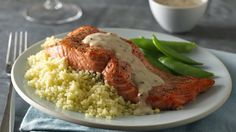 Grilled salmon served with a delicious garlic sauce makes for a perfect dinner—quick and easy to prepare.