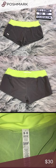 Under Armour shorts Under Armour neon yellow and gray shorts. In new condition! Built in lining. Size medium. Same or next day shipping! Under Armour Shorts