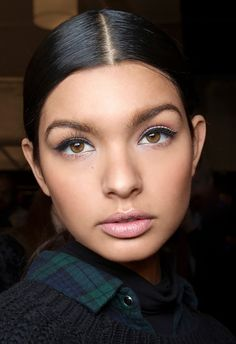 Fall 2016 Top Beauty Trends via @byrdiebeauty - A flick of black liner, long lashes, and a perfect nude lip—this doll-like look was seen on runways like Oscar de la Renta, Rachel Zoe, and more.