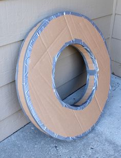 Check out this awesome craft to create a cardboard ship wheel and fake portholes as party decorations for your next pirate themed birthday bash!