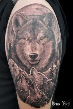 Black and grey wolf shoulder tattoo by Bruce Riehl