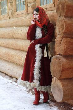 Russian girl standing at the wooden house