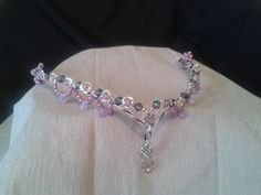 Celtic Rose:  A stunning forehead tiara adorned with silver tone rosebuds set with pink pearls and a two tone pink/green glass bead with pink beaded swags and a misted lilac drop, the centre piece is a celtic style patern and a smoked swarvoski heart crystal the drop is approx 2.5 ins. £65