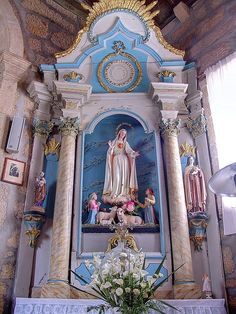 .Our Lady of Fatima with the 3 shepherd children