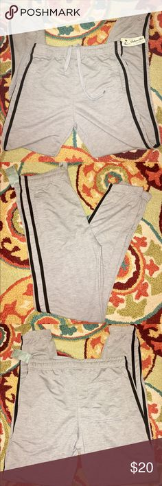 """""""""""SOLD""""""""ISLANDER CLOTHING CO.JOGGERS ISLANDER CLOTHING CO. SOFT GREY STRAIGHT LEG JOGGERS WITH ELASTIC ANKLES WITH WIDE ELASTIC WAISTBAND N DRAWSTRING WITH SINGLE REAR POCKET N FRONT SLIDE N POCKETS WITH DOUBLE BLACK STRIPS NEW WITH TAG MEN SIZE MEDIUM islander clothing co. Pants Sweatpants & Joggers"""