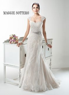 Delicate, detachable cap-sleeves adorn the shoulders of this slim A-line gown, Joelle by Maggie Sottero. Lovely!